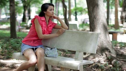 Thumbnail for Depressed Girl Sitting Park Bench