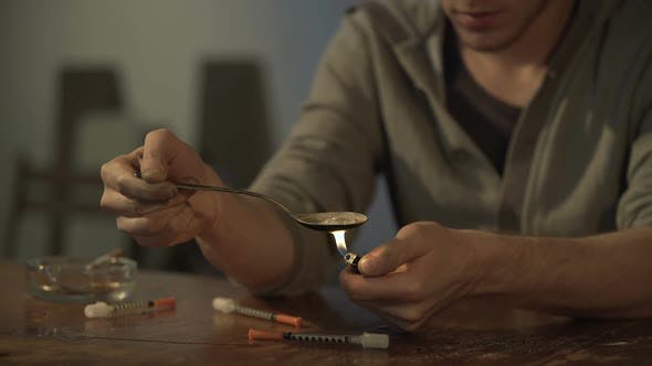 Thumbnail for Man Sitting at Derelict Room, Preparing Drug Dose for Injection, Video Sequence