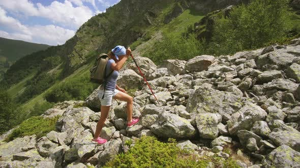 Thumbnail for Woman Backpacker Hiking in Mountain