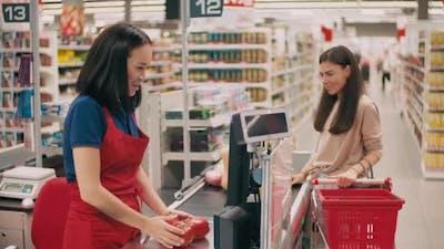 Cashier Weighing Vegetables In Hypermarket