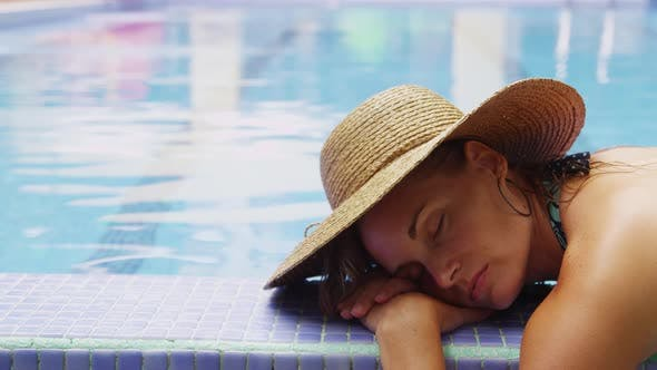 Thumbnail for Woman laying by pool. Shot on RED EPIC for high quality 4K, UHD, Ultra HD resolution.