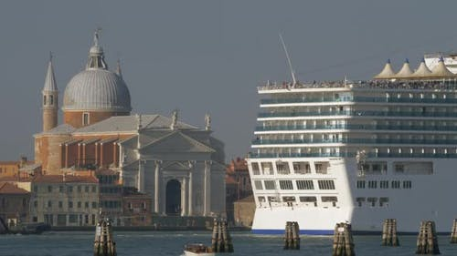 Cruise liner sailing by Church of the Santissimo Redentore in Venice, Italy