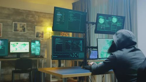 Bearded Cyber Criminal Wearing a Hoodie