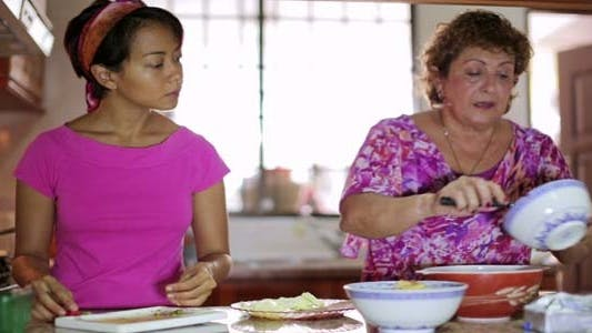 Thumbnail for Mother & Daughter Preparing Food At Kitchen 2