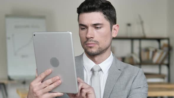 Thumbnail for Businessman Browsing and Scrolling on Tablet