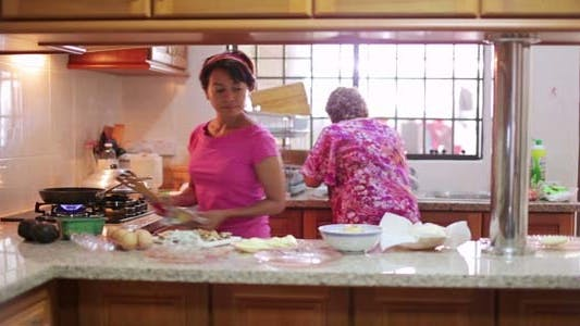 Thumbnail for Mother & Daughter Preparing Food At Kitchen 1