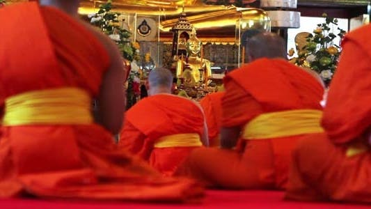 Thumbnail for Buddhist Monks Pray In Temple 1