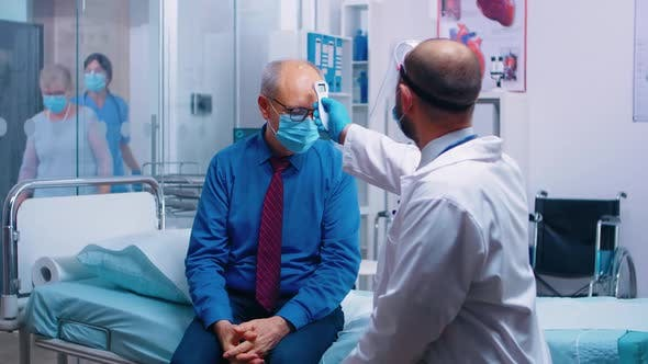 Doctor Using Infrared Thermometer