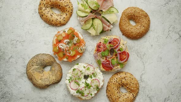 Thumbnail for Bagel Sandwiches with Various Toppings, Salmon, Cottage Cheese, Hummus, Ham, Radish and Fresh Herbs