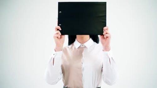 Businesswoman with a black folder