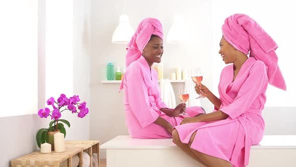 Thumbnail for Two African American friends drinking wine in spa