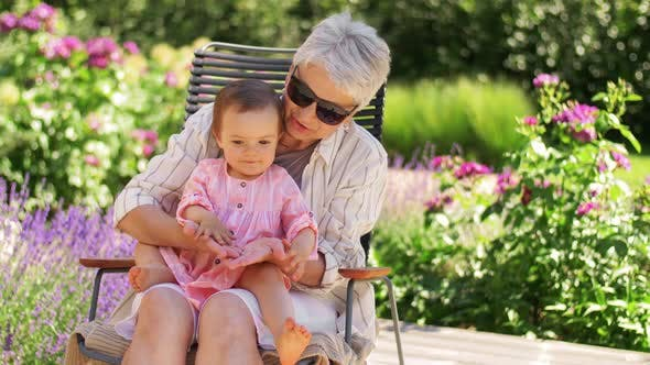 Thumbnail for Happy Grandmother and Baby Granddaughter at Garden
