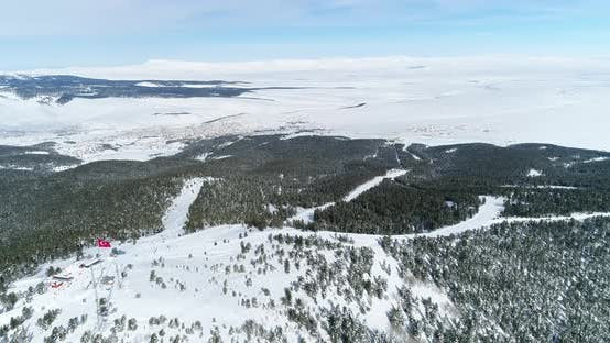 Thumbnail for Ski Center And Snowy Mountains Forest Aerial View 4