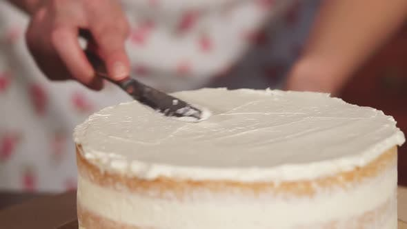 Thumbnail for Rotating Cake with Butter Cream, Womans Hand Are Touching By Knife