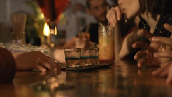 Thumbnail for Bartender Serving Alcoholic Beverages to Customers