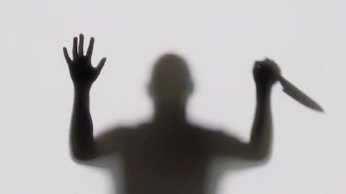 Silhouette of a Knife Wielding Killer