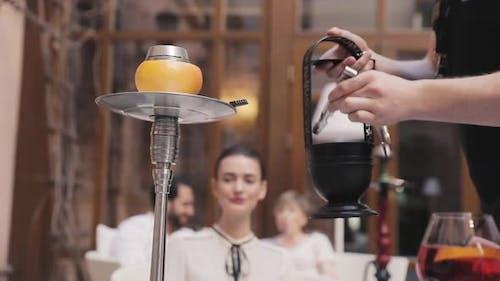 Prering Shisha. Man Hands Putting Charcoal Into Hookah Bowl