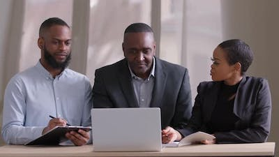 Diversity Business Team People Brainstorm Using Laptop Computer at Workplace Writing