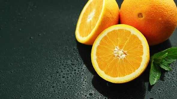 Thumbnail for Orange with Leaf on Wet Table