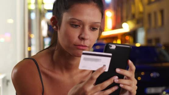 Thumbnail for Pretty brunette female on Paris street shopping online with phone and card