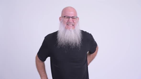 Thumbnail for Stressed Mature Bald Bearded Man Having Back Pain