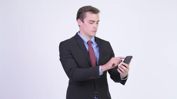 Thumbnail for Young Happy Handsome Businessman Using Phone