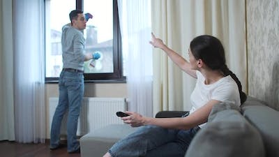 Husband Washes the Window and Wife Watches Tv