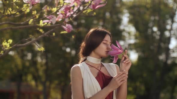 Spring Beauty Portrait of a Woman with Flower Outdoors