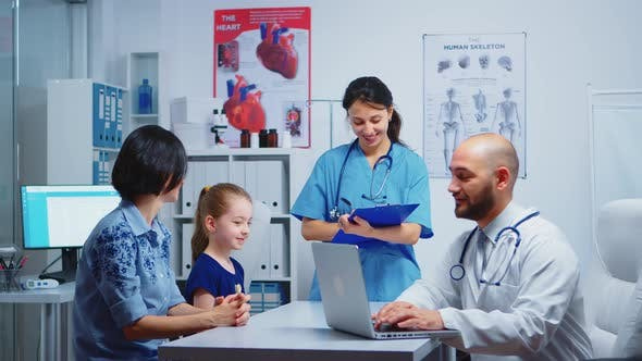 Doctor Asking Nurse for Pills