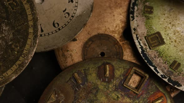 Thumbnail for Rotating stock footage shot of antique and weathered watch faces - WATCH FACES 015