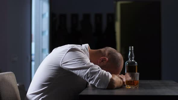 Thumbnail for Depressed Man in Alcohol Abuse Lying on the Table
