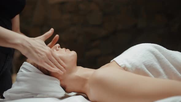 Thumbnail for Woman Receiving Facial Massage in Spa, Wellness Body and Skin Care, Face Treatment with Moisturizer