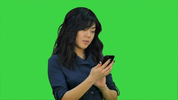 Cover Image for Businesswoman Using of Mobile Phone on a Green Screen, Chroma Key