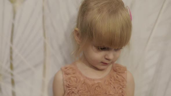 Thumbnail for Happy Three Years Old Girl Make Faces and Dancing. Cute Blonde Child