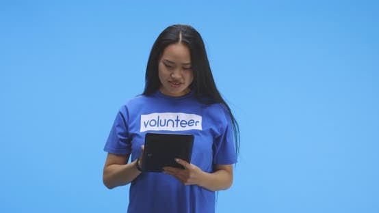 Thumbnail for Female Volunteer Using Tablet