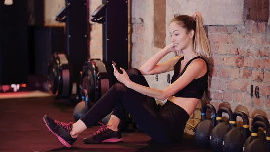 Thumbnail for Fit Female Athlete Using Smartphone