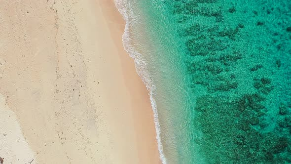 Thumbnail for Tropical fly over abstract shot of a white paradise beach and blue water background in vibrant 4K