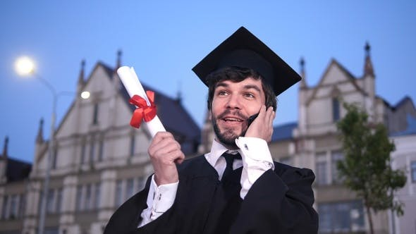 Thumbnail for Graduation: Happy Student Calling Friends After Graduation.