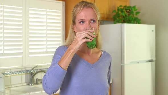 Thumbnail for Mature woman drinking fresh juice