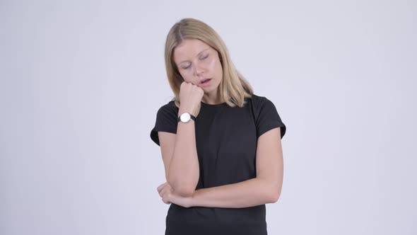 Cover Image for Young Stressed Blonde Woman Looking Bored and Tired