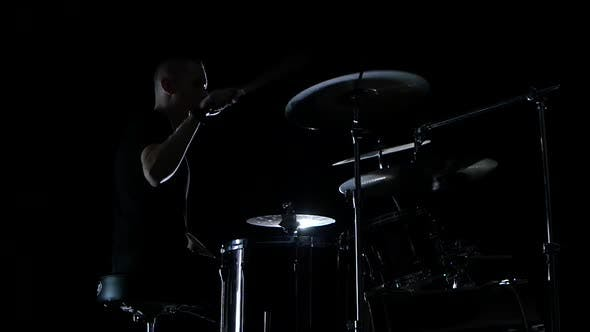 Thumbnail for Good Music in the Perfomance of a Professional Drummer. Side View. Black Background. Slow Motion