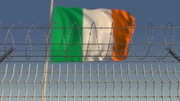 Thumbnail for Waving Flag of Ireland Behind Barbed Wire Fence
