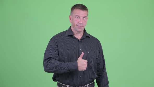 Thumbnail for Macho Mature Businessman Giving Thumbs Up