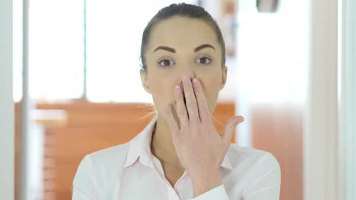 Shock Gesture by Woman in Office