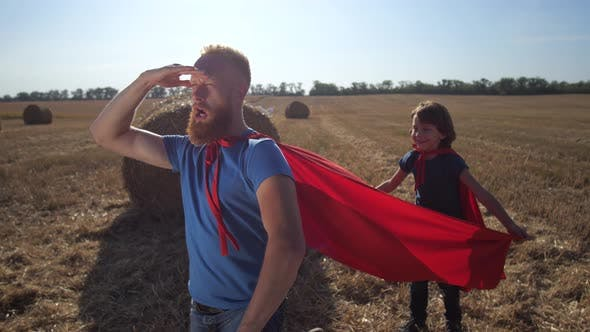 Thumbnail for Brave Man in Superhero Role Playing with Son