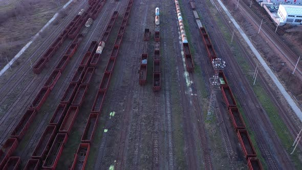 Thumbnail for Aerial view of colorful freight trains on the railway station