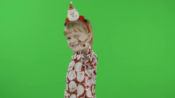 Thumbnail for Happy Beautiful Little Girl in a Shirt with a Santa Claus