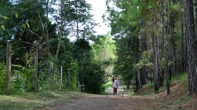 A woman walking into the woods