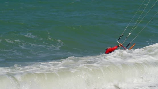 Active People Practicing Human Kitesurfing and Windsurfing