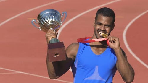 Excited Latin Sportsman Posing to Paparazzi Showing His Trophies, Successful Man